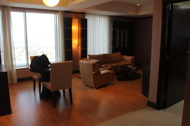 Emirates Grand Hotel Dubai UAE Review – wooden floor with brown leather couches