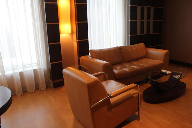 Emirates Grand Hotel Dubai UAE Review – wooden floor with leather couches