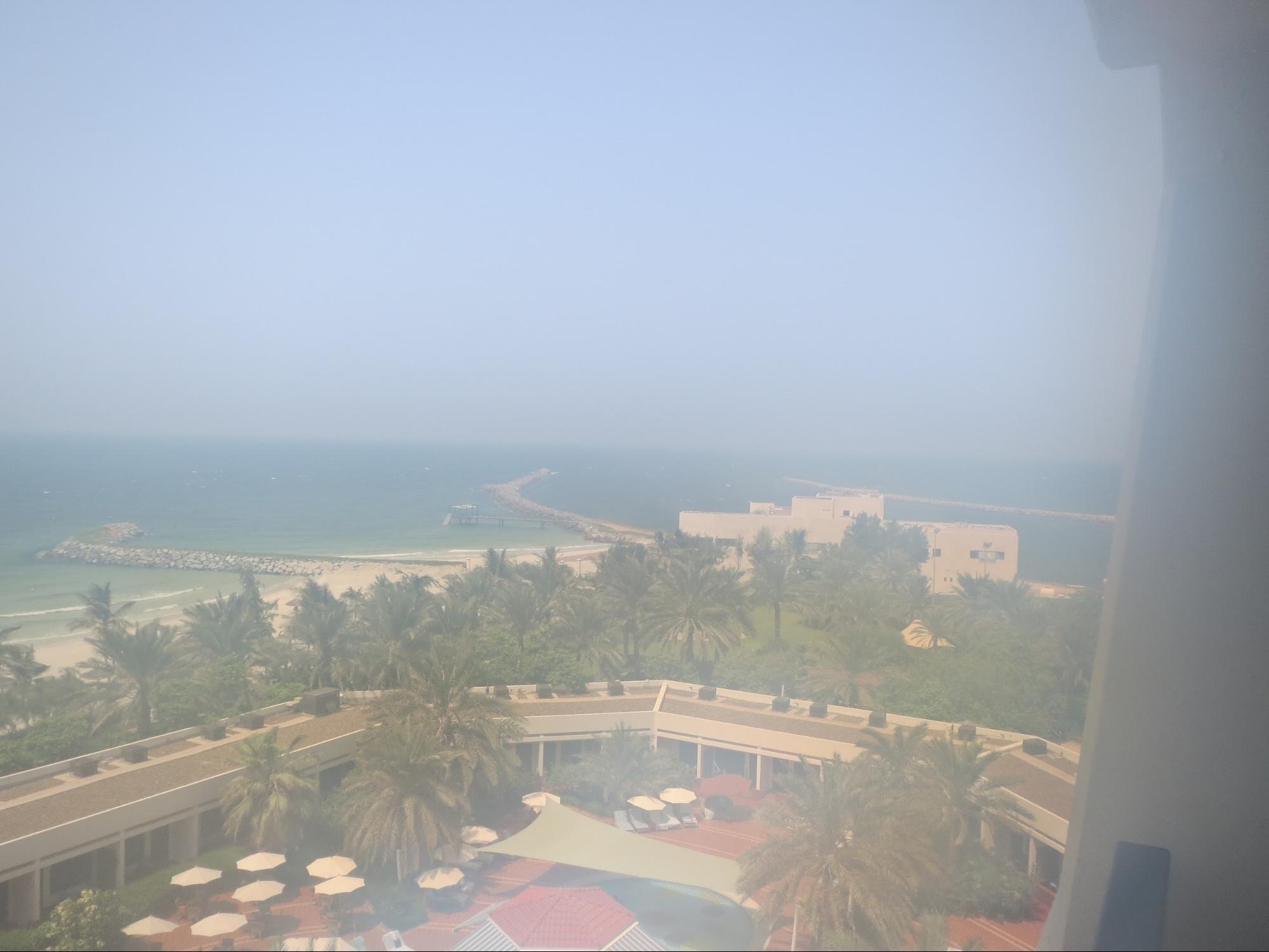 Kempinski Hotel, Ajman Review - Balcony Outside View - palm gardens, pool & beach