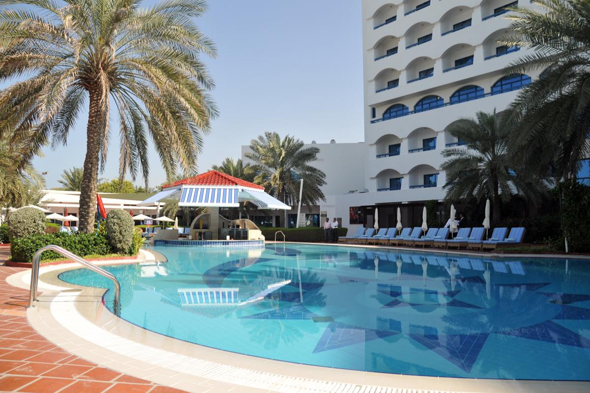 Kempinski Hotel, Ajman Review - Relax while sitting at pool area